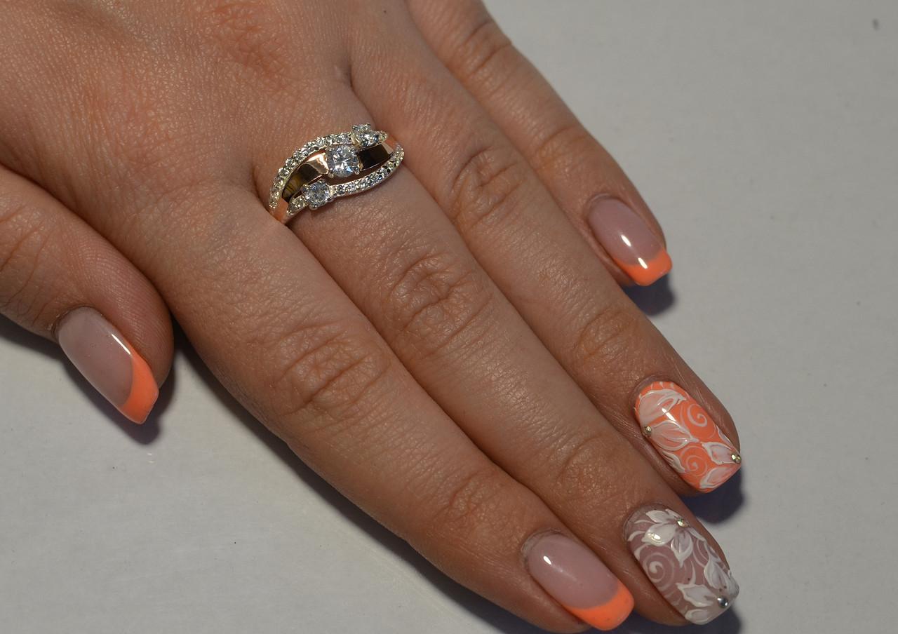 Серебряное кольцо с золотыми вставками 080к