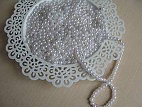 Жемчуг белый диаметр бусин 0,6 см. Вес упаковки 10 гр