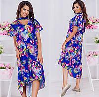Молодежное яркое платье асимметричной длины в цветочный принт.