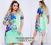 Женское шифоновое платье в цветочный принт, сзади декорировано оригинальным разрезом.