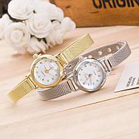 Женские наручные часы с металлическим ремешком