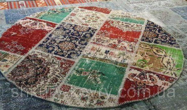 Кольоровий потертий килим печворк круглий з вовни і бавовни