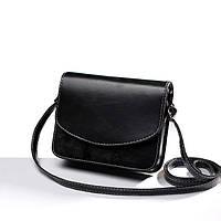 Легкая и изящная маленькая черная сумочка