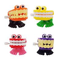 Заводная игрушка Зубы  VVM-4736