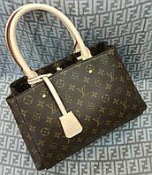 Женская мини сумка Louis Vuitton, коричневого цвета с бежевыми ручками. Материал: эко кожа.