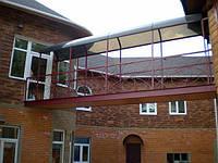 Металлические навесы над балконами и подвалами
