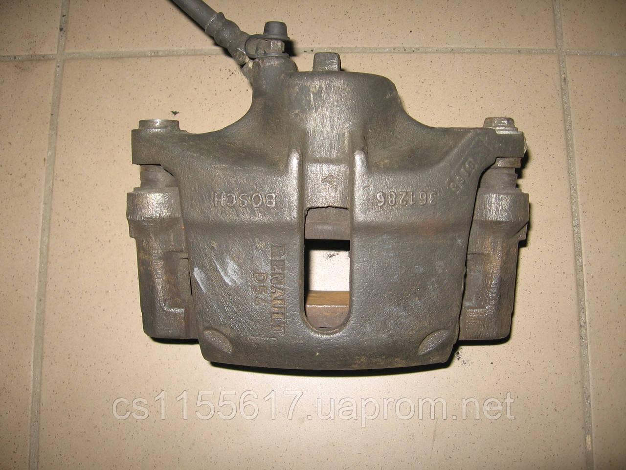 Тормозной суппорт передний правый 7701207787 б/у на Renault Kangoo год 1997-2007 (R14, D=54)