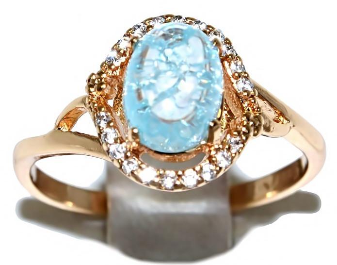Кольцо ХР. Цвет:позолота.Камни: белый циркон и бирюзовый кристалл .Ширина 11 мм. Есть 16 р. 17 р. 18 р.