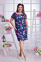 Стильное летнее платье в цветочный принт, по бокам карманы.