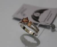 Серебряное кольцо с вставкой золота