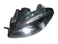 Фара передня ліва в чорному корпусі (під електрокоректор) Сенс / Ланос, 96304610