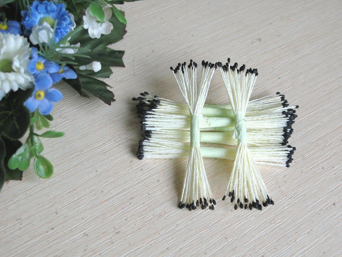 Тайские тычинки, черные, мелкие на кремовой  нити, 23-25 нитей, 50 головок
