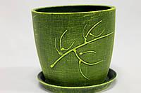 Зеленый цветочный вазон.