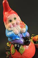 Садовая фигура Гном на апельсине