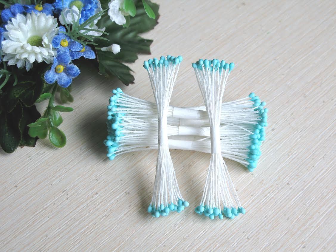 Тайские тычинки - шарики, голубые,  на белой  нити, 23-25 нитей, 50 головок