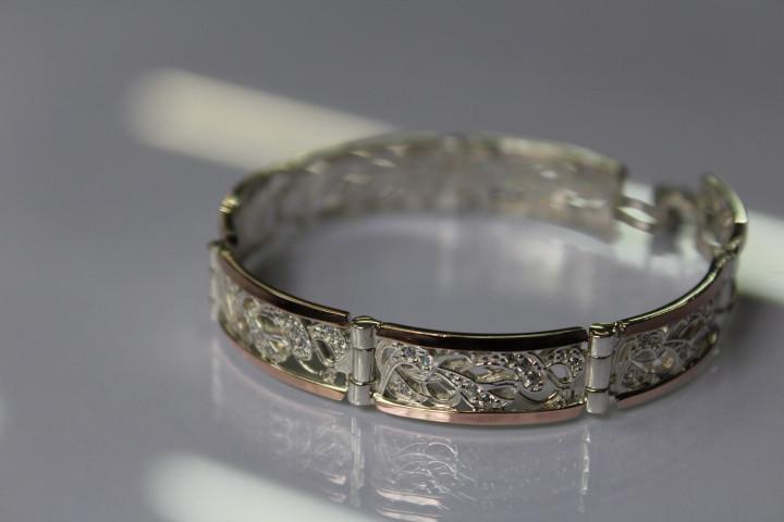 Браслет серебряный с золотыми вставками