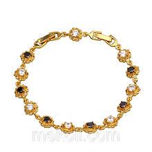 Позолоченный женский браслет с чёрными и белыми стразами