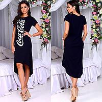Женское легкое платье асимметричной длины с карманами по бокам.