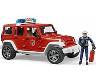 Игрушка - джип Пожарный Wrangler Unlimited Rubicon + фигурка пожарника М1:16 BRUDER (02528)
