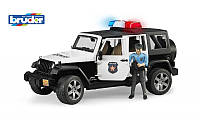 Игрушка - джип Полиция Wrangler Unlimited Rubicon + фигурка полицейского М1:16 BRUDER (02526)