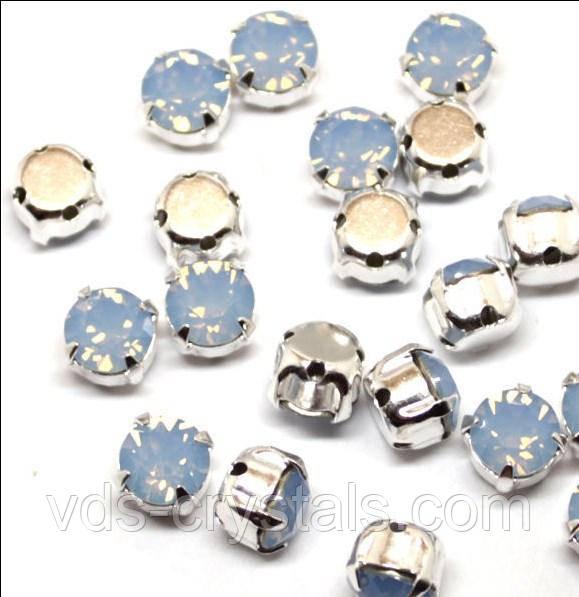 Кристали Swarovski в срібних родированных касти 17704 Air Blue Opal ss39