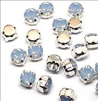 Кристаллы Swarovski в серебряных родированных кастах 17704 Air Blue Opal