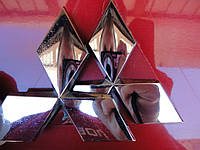 Эмблема (значок) на решетку Mitsubishi Lanser X / Outlander XL