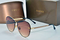 Солнцезащитные очки Gucci коричневые
