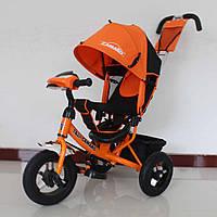 Детский трехколесный велосипед Tilly Camaro T-362, фара, большой капюшон, родительская ручка, багажник, оранже