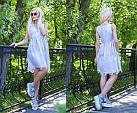 Летнее платье с V - образным вырезом и шнуровкой на груди.   Клешенная юбка украшена дорогим кружевом.