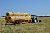 Прицеп-платформа для перевозки рулонов с сеном соломою