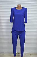 Костюм женский( брюки с блузой)