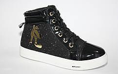 Черные блестящие ботинки