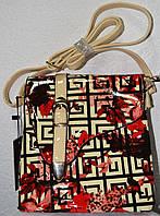 Женская лаковая сумочка