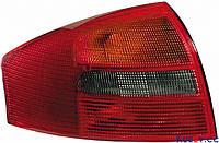 Фонарь задний Audi A6 седан 01-05 левый (HELLA) зад ход красно-дымч.