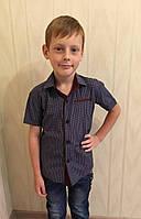 Рубашка для мальчика синяя с коричневой клеткой с однотонной вставкой с коротким рукавом