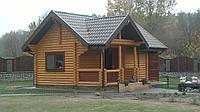 Баня деревянная из оцилиндрованного бруса (площадь 48 м.кв.)
