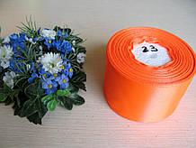 Лента атласная. Ширина 5 см.Цвет неоново оранжевый.