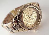Часы женские Tory Burch в золотом цвете