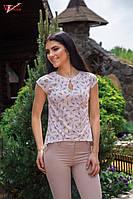 Блузка с коротким рукавом,спереди застежка на пуговицу в форме капельки.