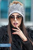 Красивая зимняя шапка с бубоном из натурального энота