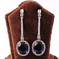 Вечерние элегантные серьги с синим камнем