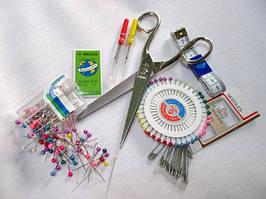 Ножиці, голки, булавки та інше приладдя для шиття