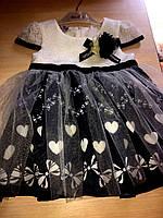 Очаровательное детское платье на девочку украшено фатином