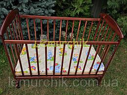 Кровать детская Наталка ольха темная (колеса, качалка, опускание борта)