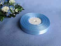 Лента 1,2 атлас однотонная.  Цвет голубой. Бобина 18 грн - 33 метра, на метраж 1 грн - метр.