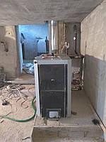 Установка твердотопливного котла (до 50 кВт)