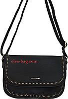 Маленькая женская сумка с волнистой каймой