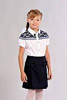 Синяя школьная юбка для девочки украшена бантиками