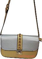 Женская сумка через плечо с пирамидками